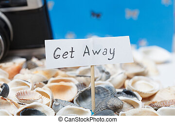 Get away message on the beach - vacation and travel concept