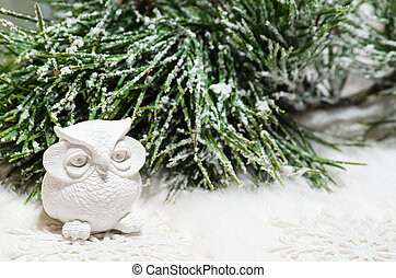 New year composition with owl and snow-covered pine branch -...