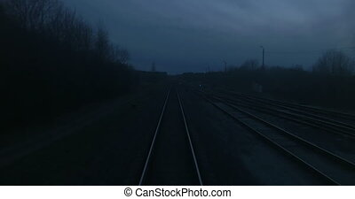 Train Passing Through Countryside - View of railroad tracks...