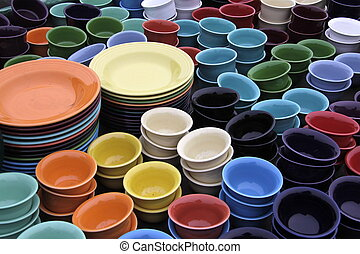 Palette of Pottery - Stacks of colorful tableware enhance a...