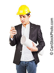 Young worker with the plan and the phone - Young worker in a...