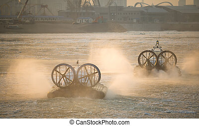 Two Russian ACV Hovercraft in Action on a Frosen River. Air...