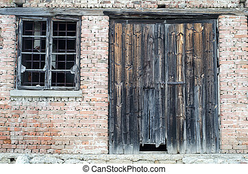 Old wooden gate at brick building