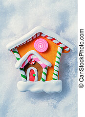 Christmas decorative house on the snow background