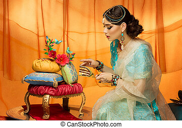 Bride with wedding cake - Beautiful young woman dressed in...