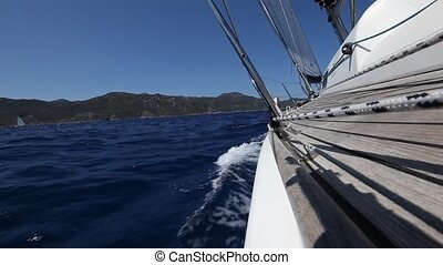 Sailing in the wind through the waves (HD) Sailing boat shot...