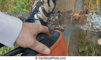 Man sawing the wood with electric tool - Close-up shot of a...