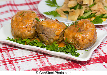 spicy meatballs in tomato sauce on white plate