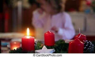 Close up of an candle on a wreath on advent first - A close...
