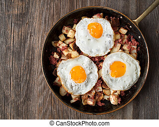rustic corned beef hash - close up of rustic corned beef...