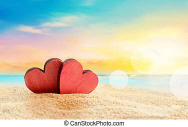 Two hearts on the summer beach - Two wooden red hearts on...