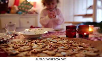 Cookies and decoration on advent first - A little girl helps...