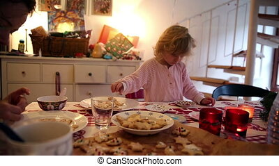 girl makes cookies on advent first - A little girl and her...