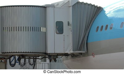People Leaving the Plane Through Jet Bridge - Undefined...