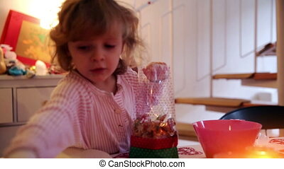 Girl filling cookies in a sachet on advent first - A little...
