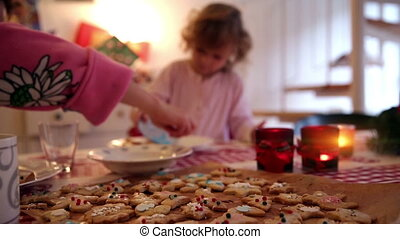 Girl making cookies on advent first - A little girl pours...