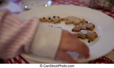 Girl pilfers a cookie on advent first - A little girl...
