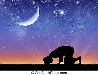 Silhouette of man praying - Concept of Islamic culture....