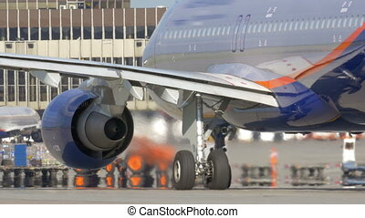 View to the passenger airplane with working engines -...