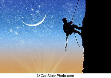 Silhouette of climber at the sunset