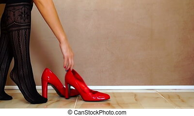 Woman Putting on Red Shoes