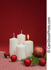white candles with red christmas baubles