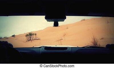 driving off-road car in the sahara - Camera car in the...