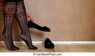 Woman Putting on Black Shoes and Walking Away