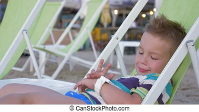 Child with smartwatch at the seaside