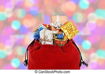 closeup of santa claus bag with christmas light bokeh...