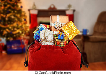 santa claus bag full of gifts in living room