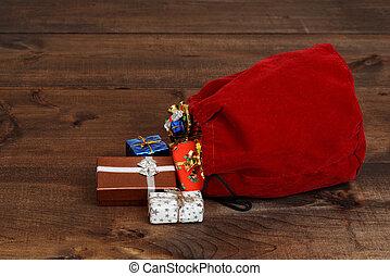 spilled santa claus bag on wood