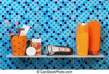 Hygiene bath tools on bathroom shelf Blue background