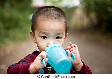 Drinking asian boy - A portrait of an asian boy drinking...