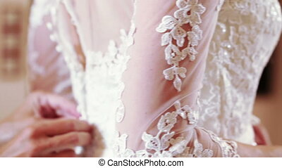 Lacing wedding dress - Mother of Bride helps lace wedding...