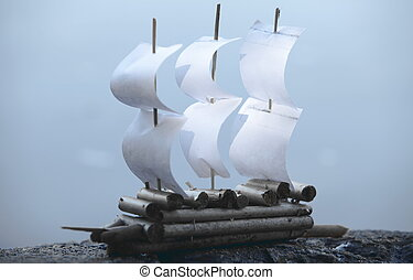 Paper Sailing ship on a blue background
