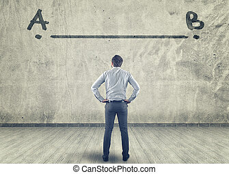 Businessman looking at a line between a to b painted on a...