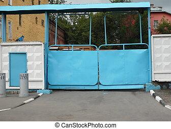 blue gate on grey wall