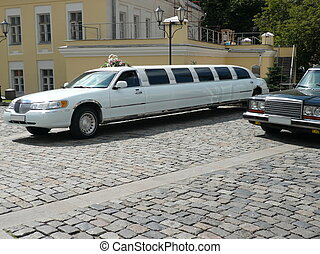 white wedding limousine  at day on street