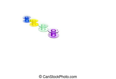 Spool. Colored bobbins for machine sewing isolated on white background