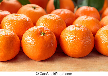 Clementines on rustic wooden table