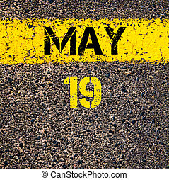 19 May calendar day over road marking yellow paint line