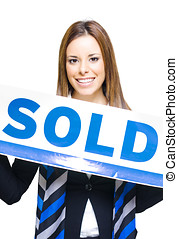 Real Estate Agent Holding Sold Sign