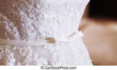 Belt wedding dressed - Beautiful bride adjusts belt wedding...