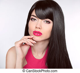 Long healthy Hair. Makeup. Manicured nails. Beautiful model girl with black straight shiny hair and sensual lips isolated on studio background. Beauty Brunette Woman.
