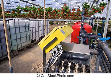 Glasshouse with plants and fertilization equipment