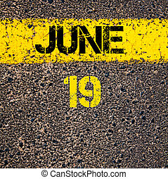 19 June calendar day over road marking yellow paint line
