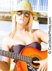 Music - Sexy And Beautiful Young Woman Holding Guitar While...
