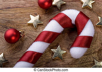 christmas candycane with red ribbon, gold star and red...