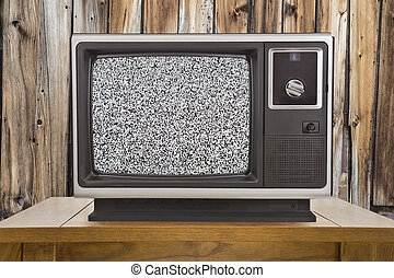 Old Television with Static Screen and Rustic Wood Wall - Old...